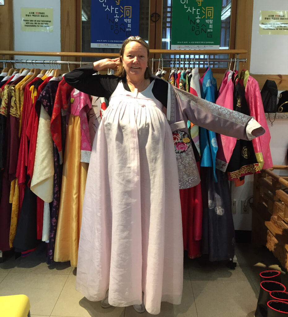 The writer trying on hanbok in Seoul.