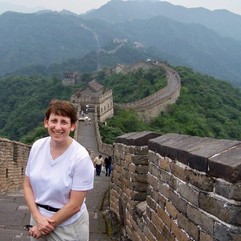 The writer visiting the Great Wall of China.