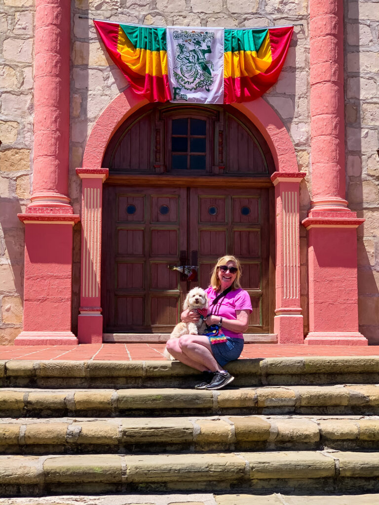 The writer with her dog at the Old Mission Santa Barbara.