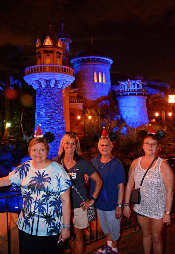 The writer with her friends at Prince Eric's Castle.