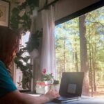 The writer working remotely from her RV.