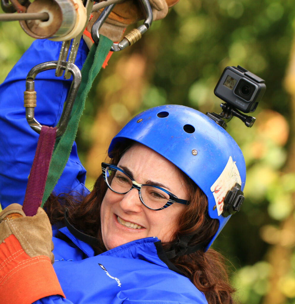 The writer zip-lining with her GoPro camera.