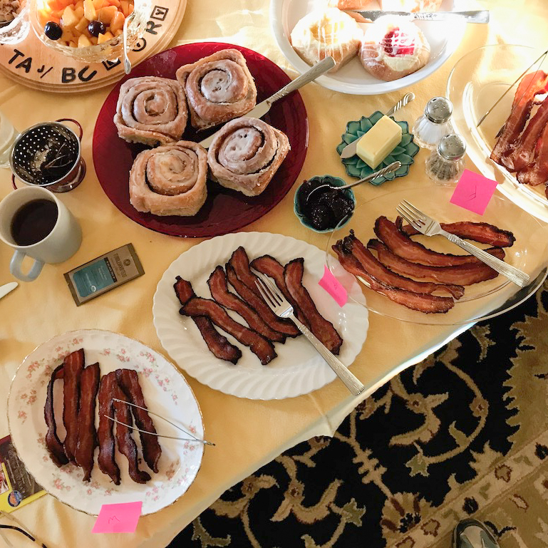 The writers creating their own bacon tasting at home.