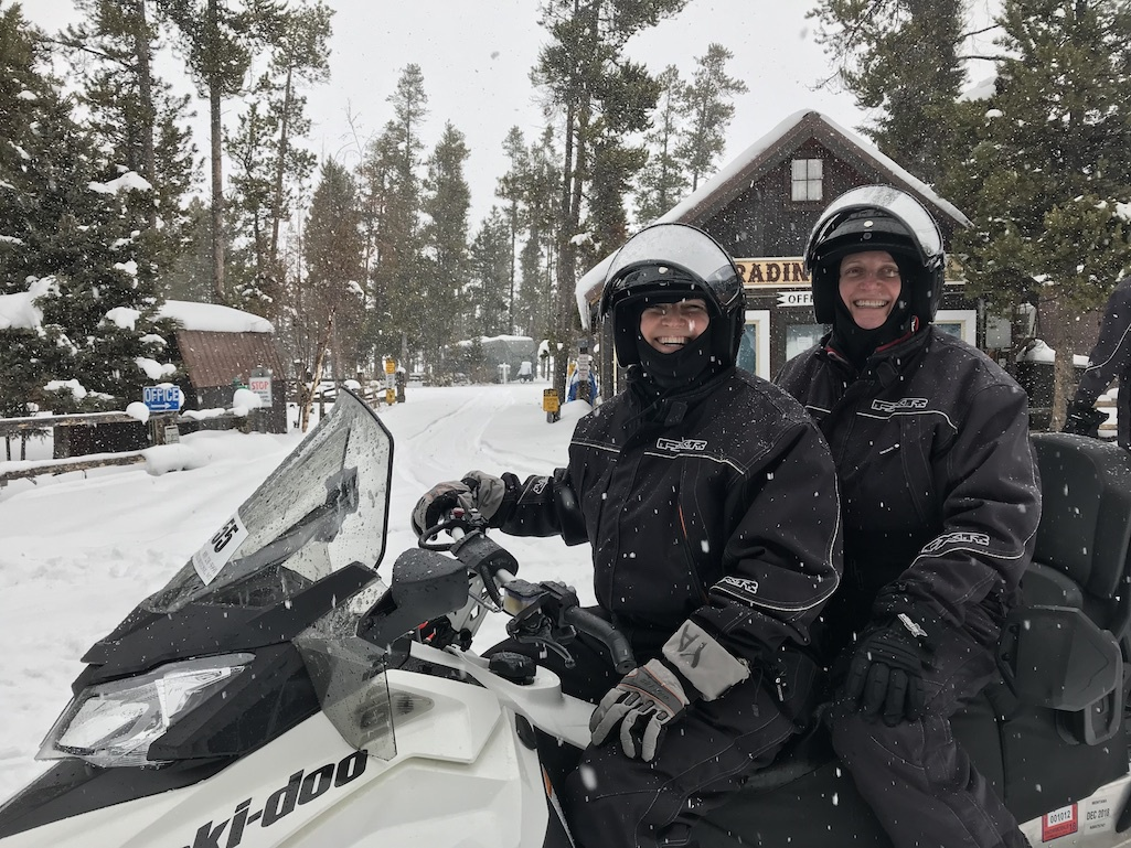The writers enjoying the experience of snowmobiling.