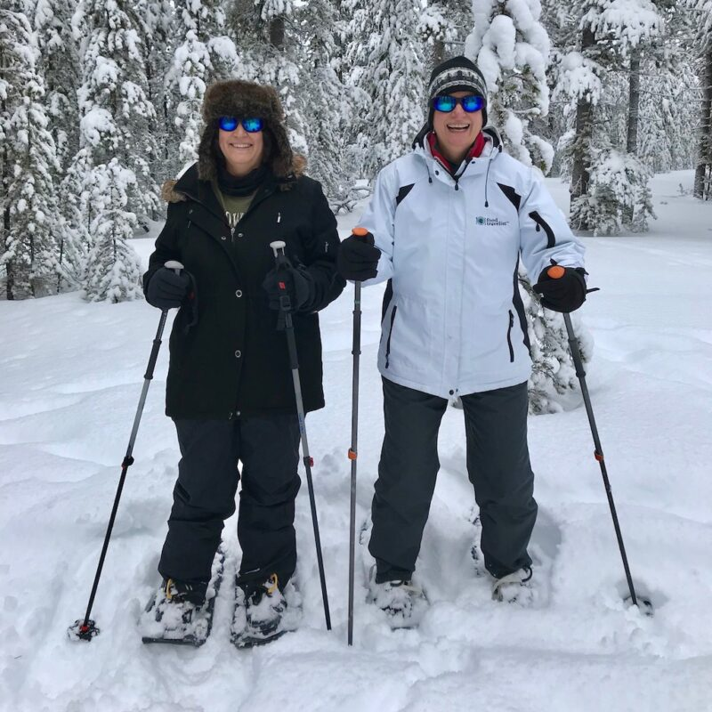 The writers snowshoeing in Yellowstone National Park.