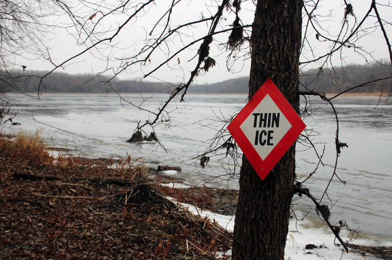 Thin ice warning sign in Minnesota.