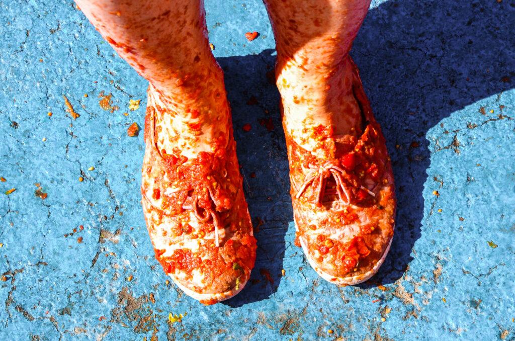 Tomato-covered shoes at La Tomatina.