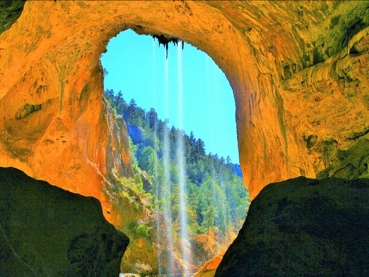 Tonto Natural Bridge seen from beneath with water flowing down