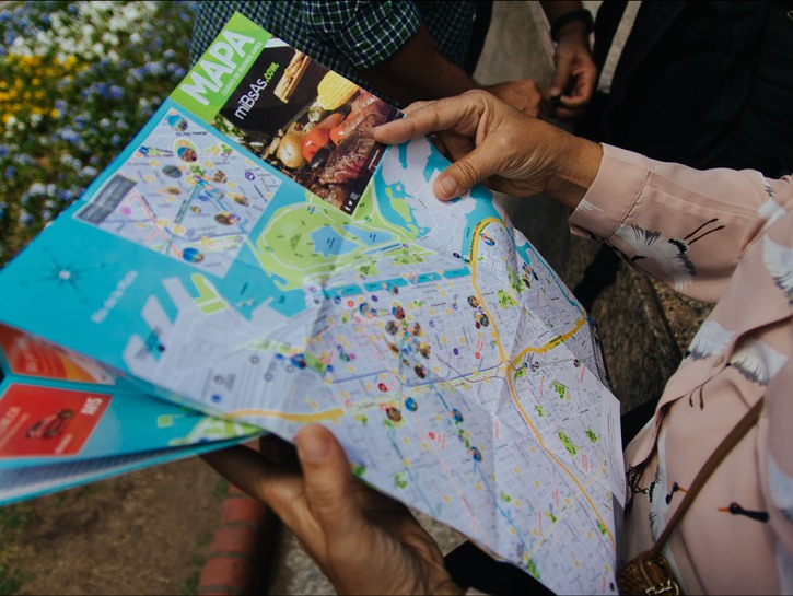 Tourist looking at a map.
