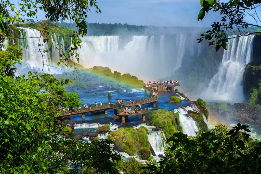 Tourists admiring Iguazu Falls in South America.
