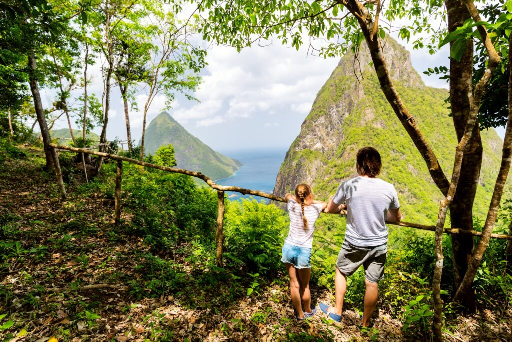 Tourists admiring Saint Lucia's Piton Peaks.