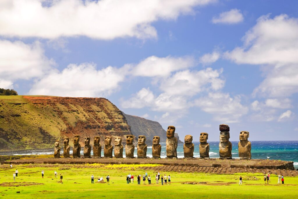 Tourists admiring the moai statues.