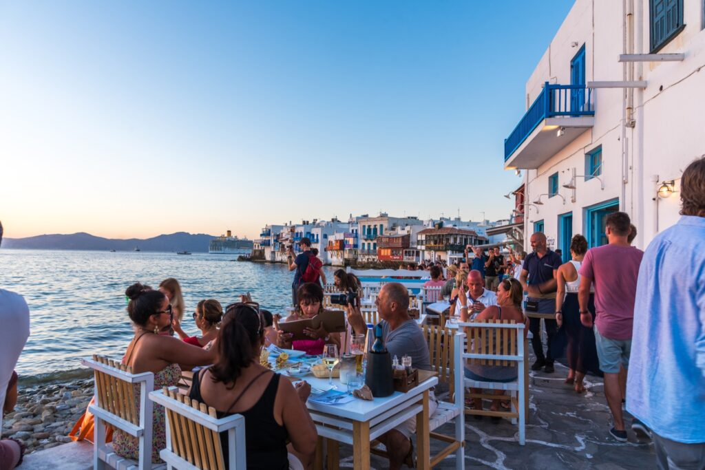 Tourists admiring the sunset from Mykonos.