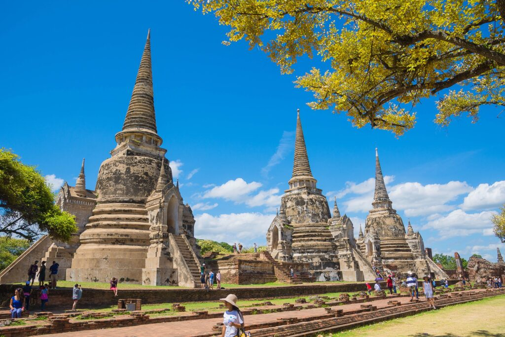 Tourists and temples in Phra Nakhon Si Ayutthaya, Thailand.