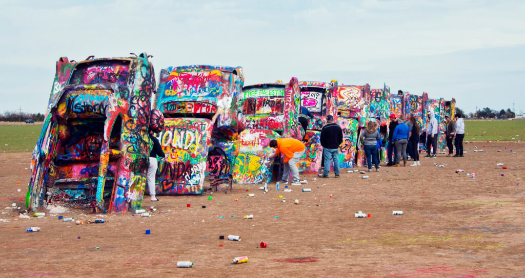 Tourists at Cadillac Ranch in Texas.