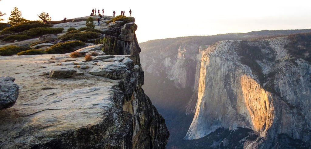 Tourists at Taft Point in Yosemite National Park.