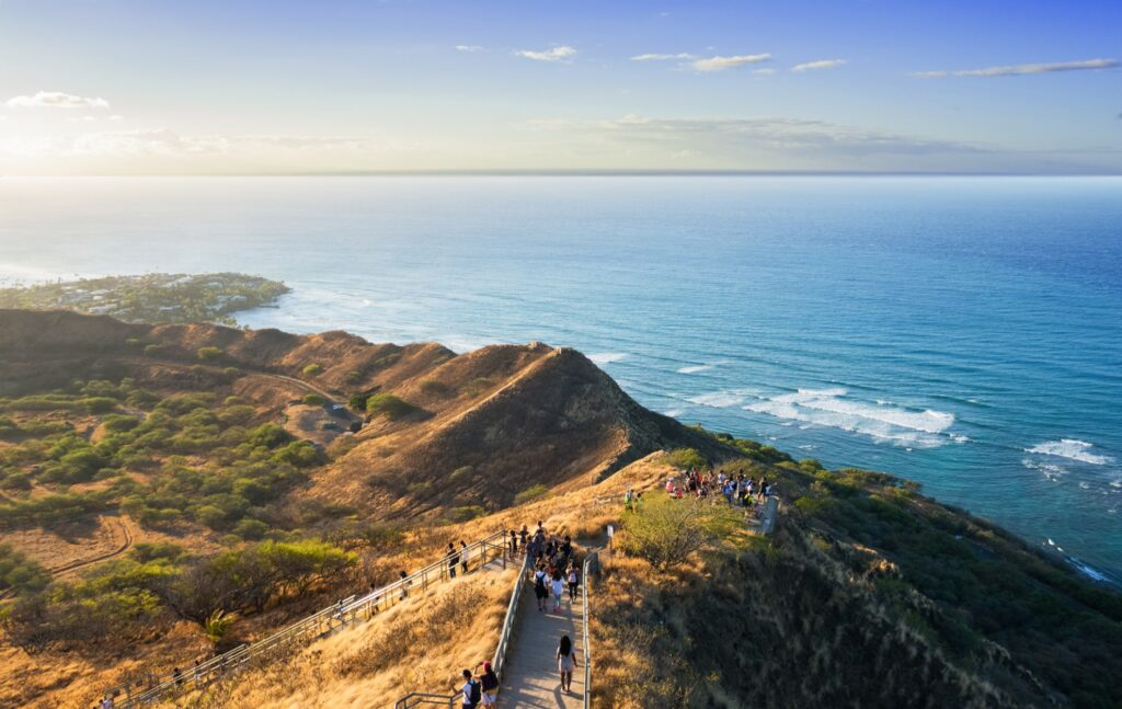 Tourists at the top of Diamond Head Crater.