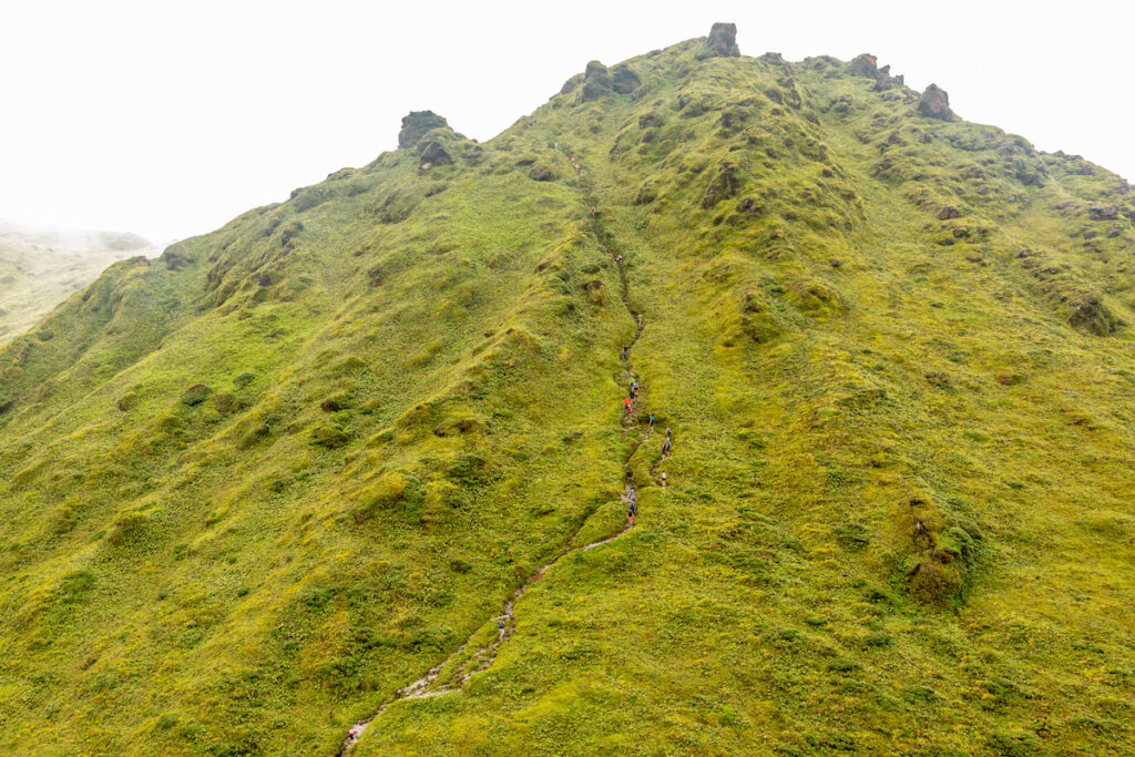 Tourists climbing Mount Pelee on Martinique.
