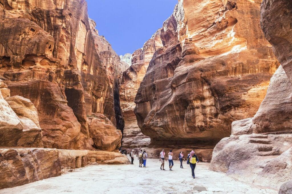 Tourists exploring Petra, Jordan.