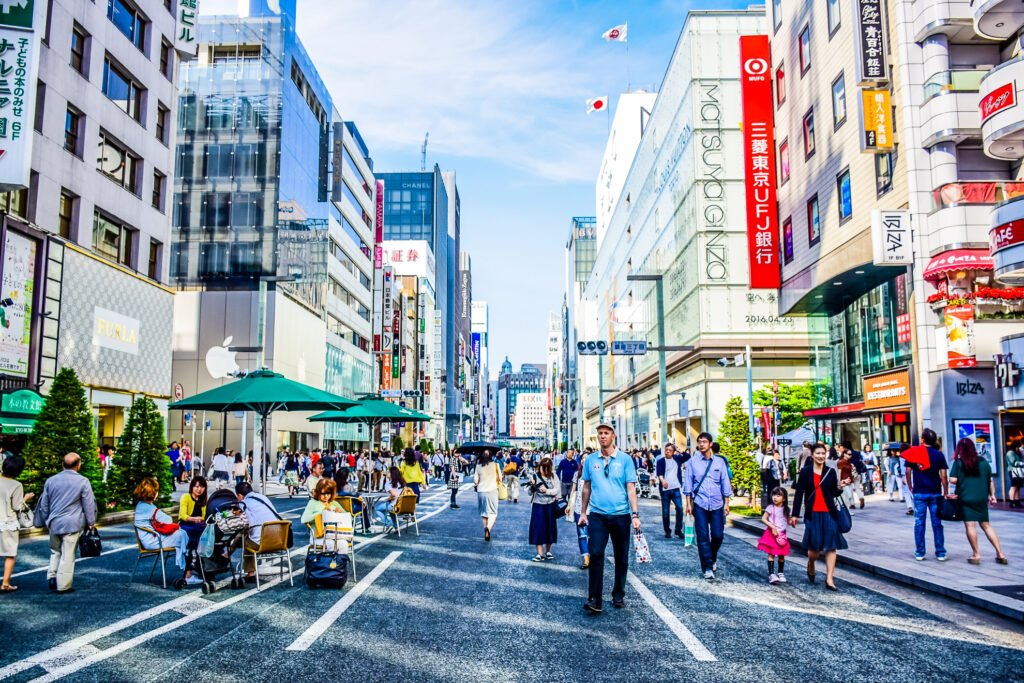 Tourists exploring the shops in the Ginza neighborhood of Tokyo