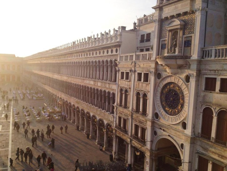 Tourists mill in St. Mark's Square, Venice, seen from above