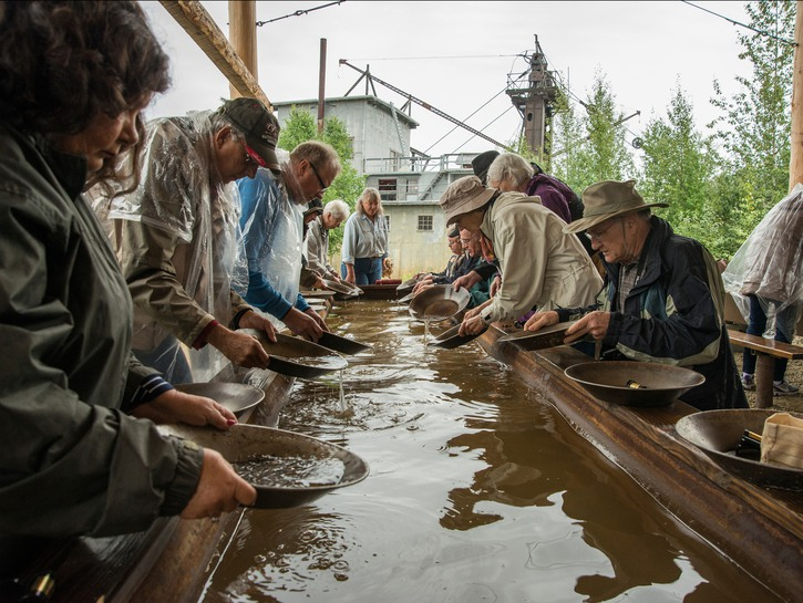 Tourists panning for gold in a water basin, Fairbanks Alaska
