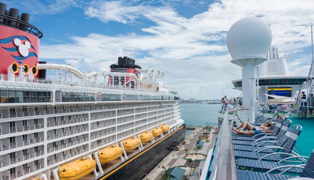 Tourists sunbathing on a Disney cruise.