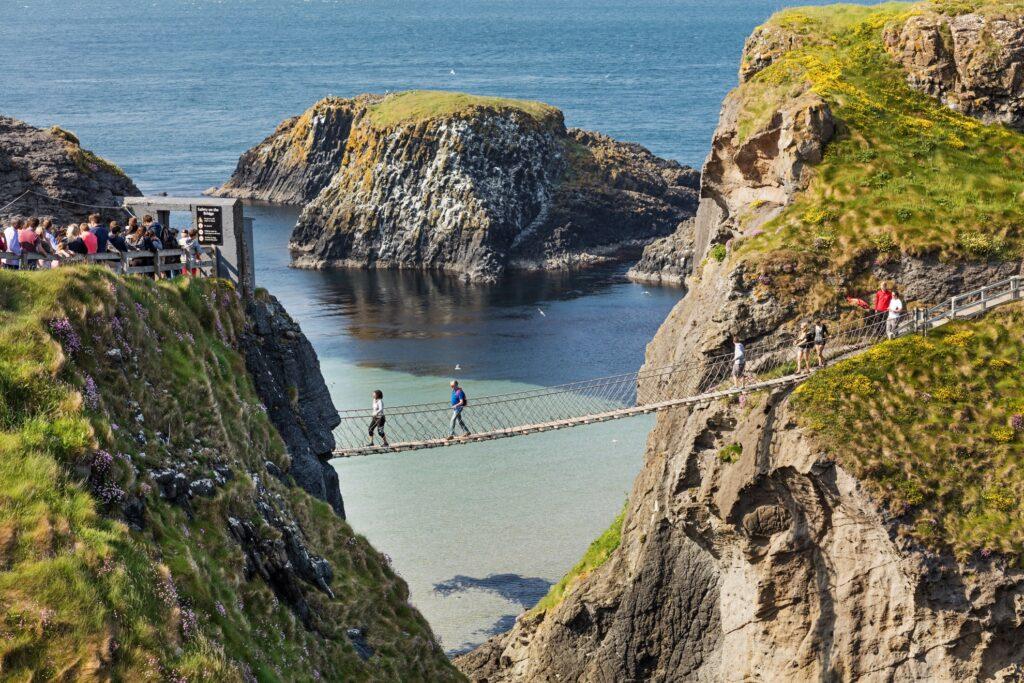 Tourists walking across the Carrick-a-Rede bridge.