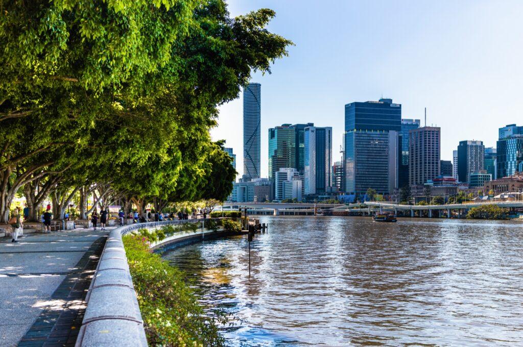 Tourists walking along Brisbane's South Bank.
