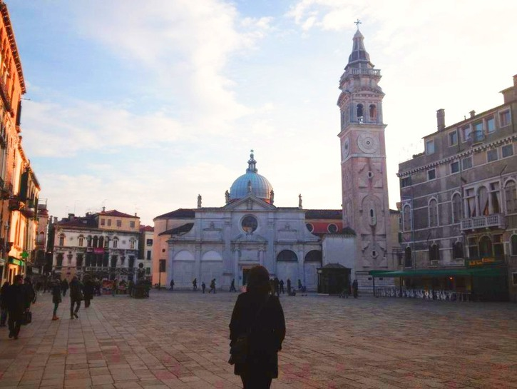 Tourists wandering through one of Venice, Italy's squares