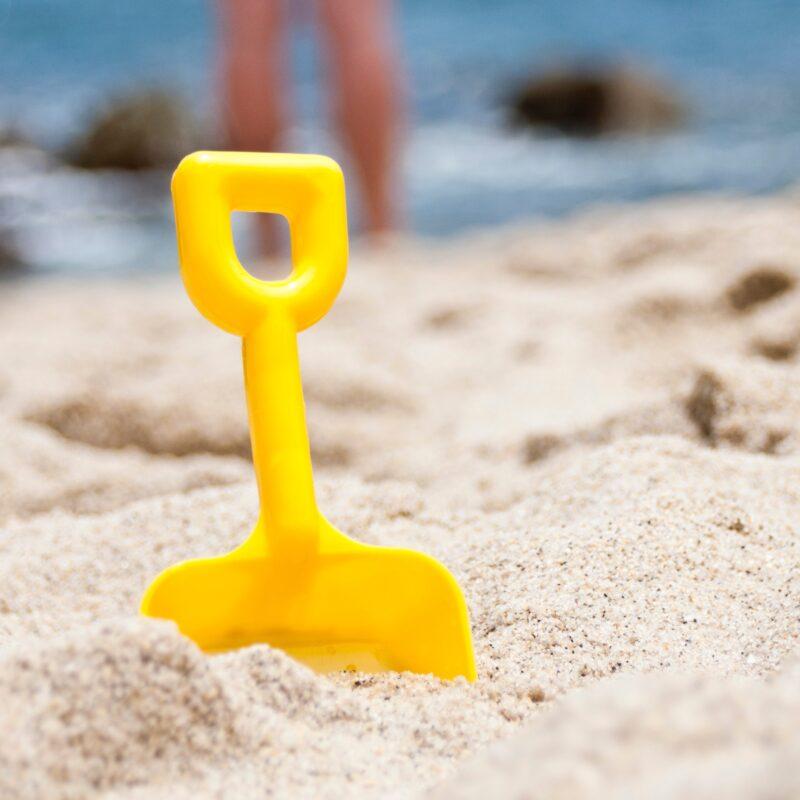 toy shovel in beach sand