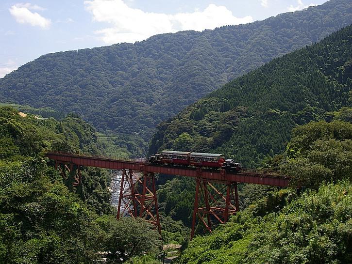 Train crossing Tateno Bridge, Japan.
