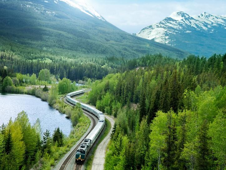 Train running through the Canadian Rockies
