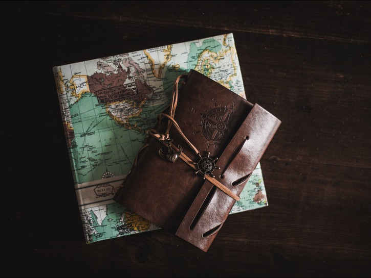 Travel journal on top of map