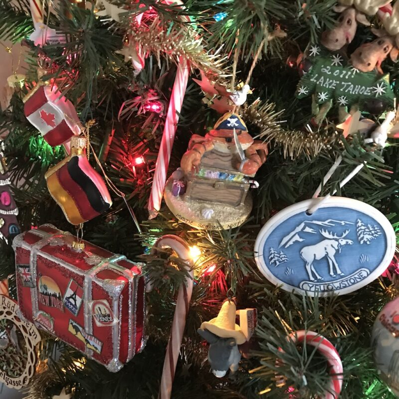 Travel-themed Christmas ornaments from the writers' trips.