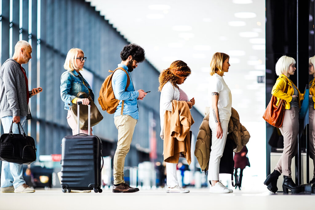 Travelers waiting in line at an airport