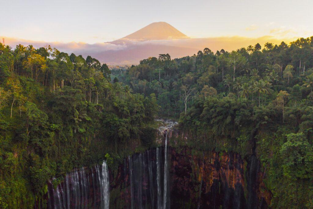 Tumpak Sewu waterfalls with Semeru in the distance.