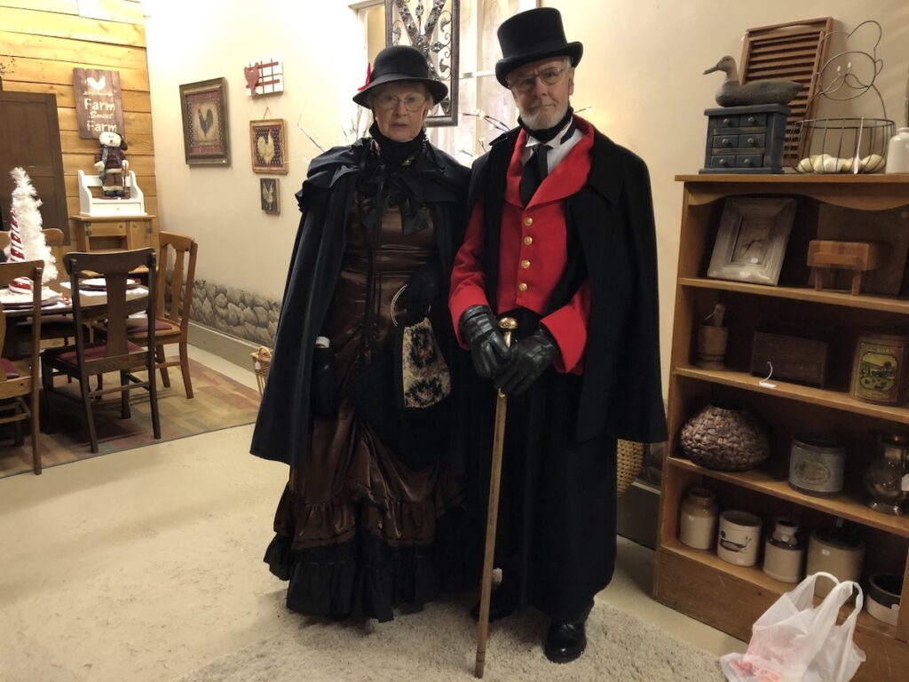 Tunkhannock visitors dressed in Victorian attire for Christmas.