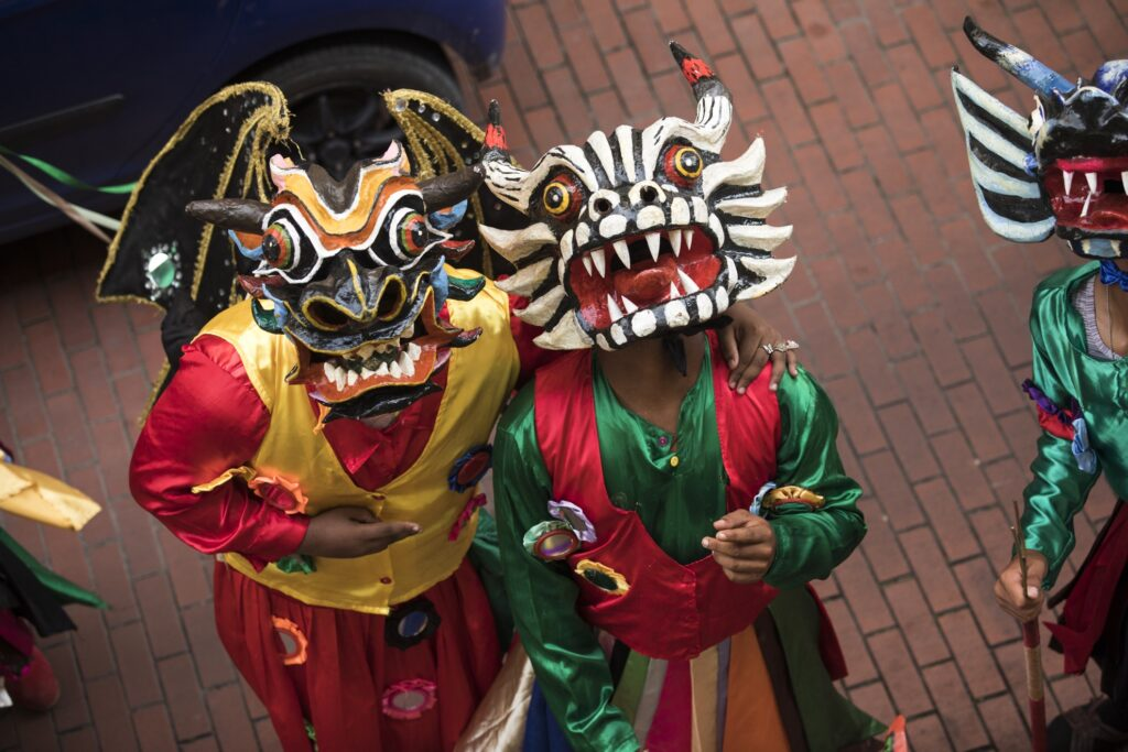 Two Carnival participants in devils' masks.