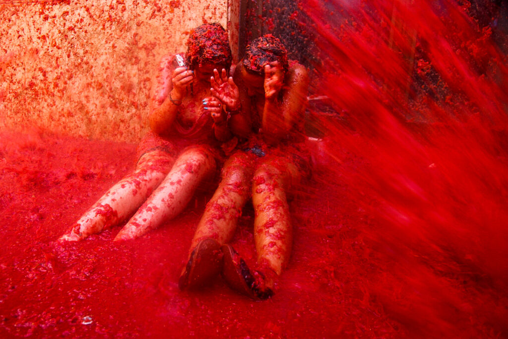 Two girls at the La Tomatina Festival in Spain.