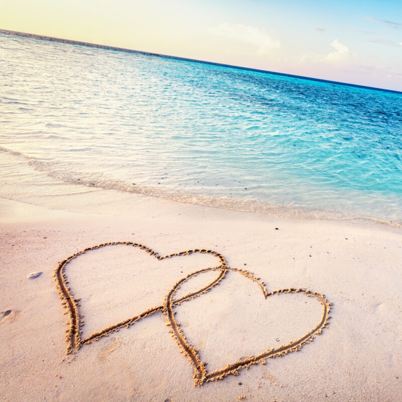 Two hearts in the sand on a beach in the Maldives.