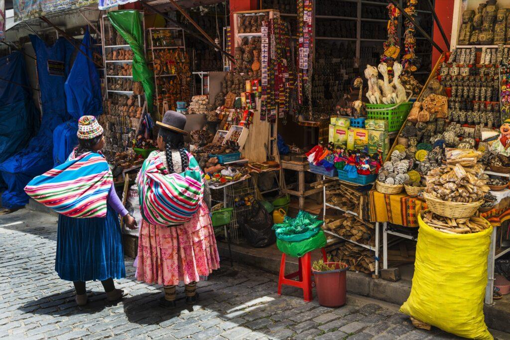 Two locals conversing in La Paz, Bolivia.