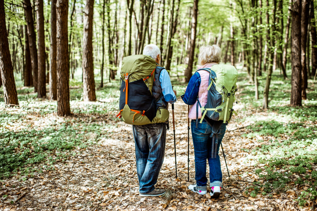 Two older travelers on a hike.
