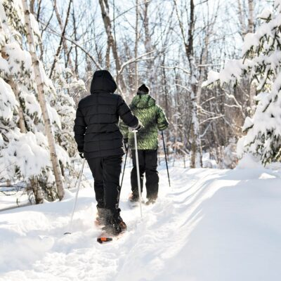 Two people snowshoeing during the winter.