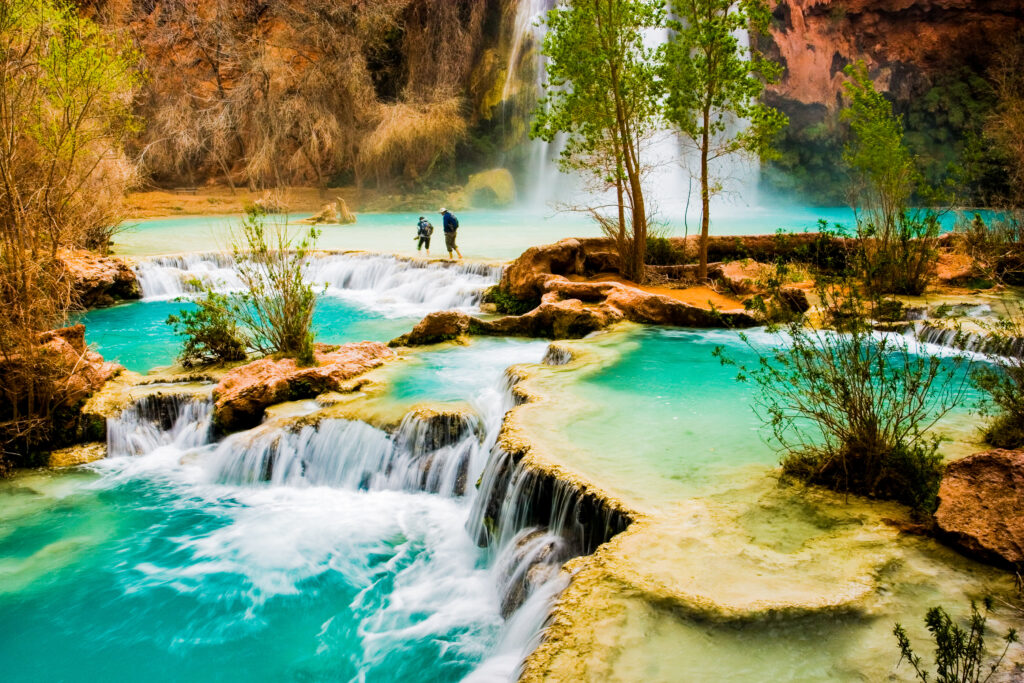 Two tourists hiking through the Havasu Falls