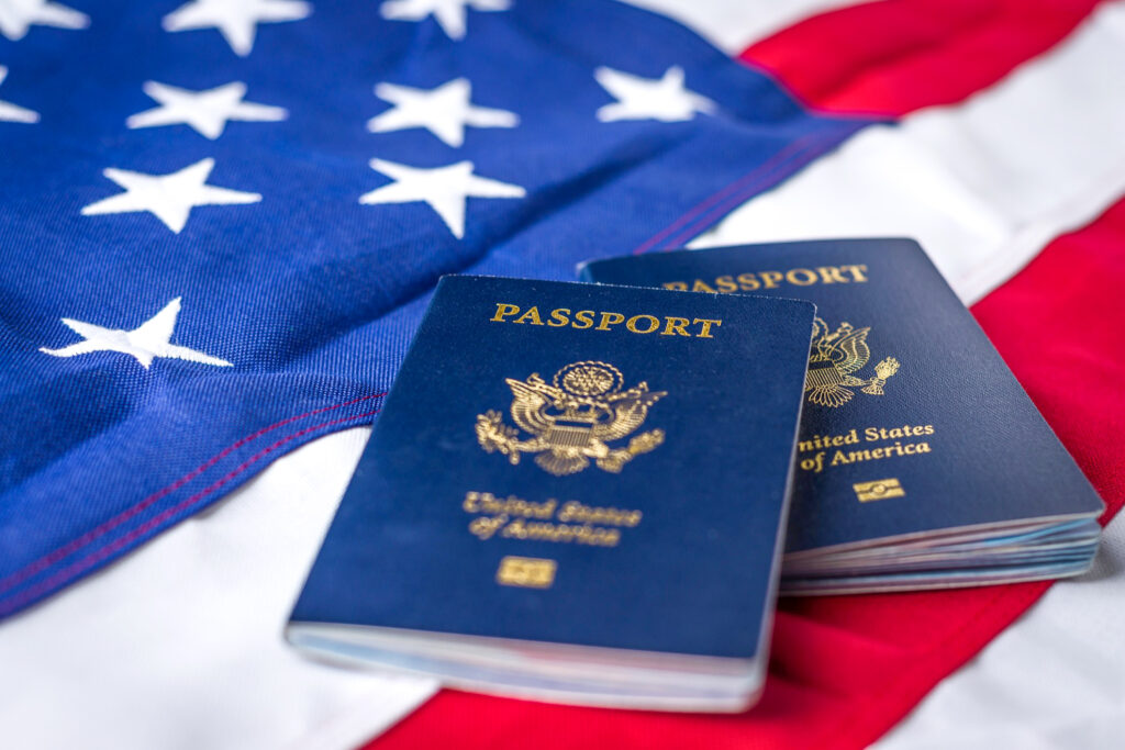 Two U.S. passports on top of the American flag.