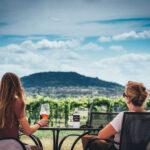 Two women relaxing, drinking Bending Brach wines.