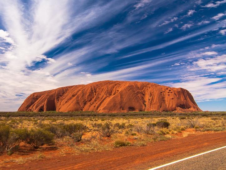 Uluru rock against a bright blue sky