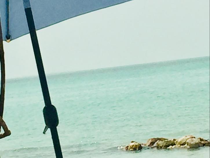 Umbrella on the secret beach San Pedro Island, Belize