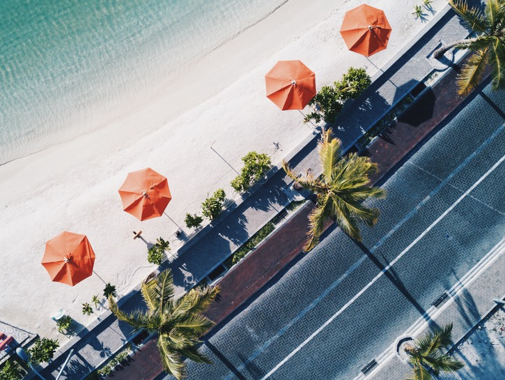 Umbrellas lining the beach seen from above, Miami
